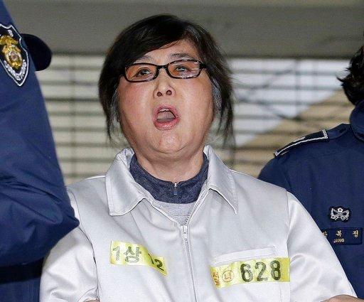 (AP Photo/Ahn Young-joon, File). FILE - In this Jan. 25, 2017, file photo, Choi Soon-sil, the jailed confidante of impeached South Korean President Park Geun-hye, shouts upon her arrival at the office of the independent counsel in Seoul, South Korea. A...