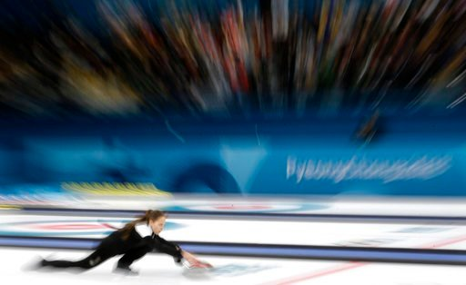 (AP Photo/Aaron Favila). Russian athlete Anastasia Bryzgalova prepares to throw the stone during their mixed doubles curling match against Norway at the 2018 Winter Olympics in Gangneung, South Korea, Tuesday, Feb. 13, 2018. The Russian athletes won br...