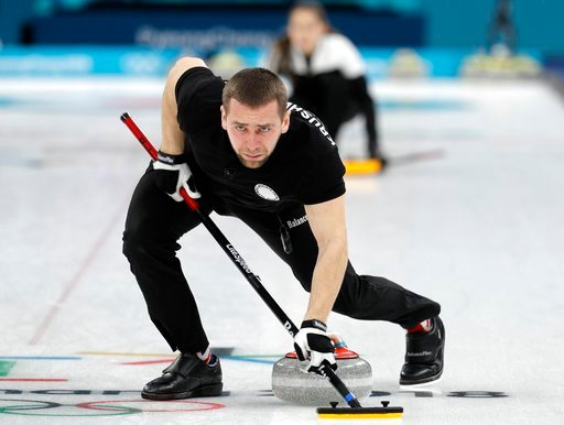 (AP Photo/Aaron Favila). Russian athlete Aleksandr Krushelnitckii sweeps ice during their mixed doubles curling match against Norway at the 2018 Winter Olympics in Gangneung, South Korea, Tuesday, Feb. 13, 2018. The Russian athletes won the bronze medal.