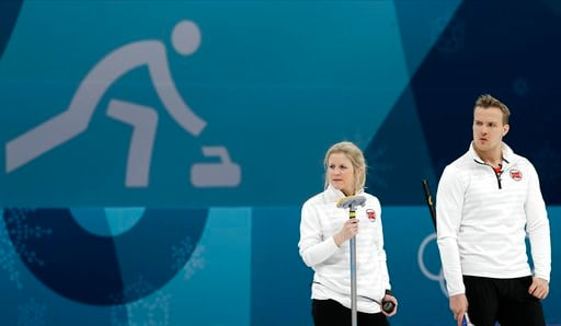 (AP Photo/Aaron Favila). Norway's Kristin Skaslien, left, and Magnus Nedregotten watch during their mixed doubles curling match against Russian athletes at the 2018 Winter Olympics in Gangneung, South Korea, Tuesday, Feb. 13, 2018. The Russian athletes...