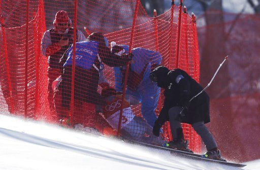 (AP Photo/Luca Bruno). Officials assist Russia's Pavel Trikhichev after he crashed during the downhill portion of the men's combined at the 2018 Winter Olympics in Jeongseon, South Korea, Tuesday, Feb. 13, 2018.