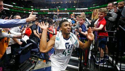(AP Photo/Rick Bowmer). Utah Jazz guard Donovan Mitchell (45) celebrates as he runs off the court following their NBA basketball game against the San Antonio Spurs Monday, Feb. 12, 2018, in Salt Lake City. The Jazz won 101-99.