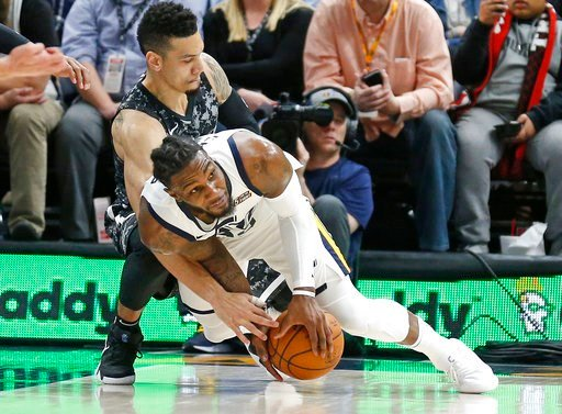 (AP Photo/Rick Bowmer). Utah Jazz forward Jae Crowder, foreground, and San Antonio Spurs guard Danny Green battle for a loose ball in the second half of an NBA basketball game Monday, Feb. 12, 2018, in Salt Lake City. The Jazz won 101-99.