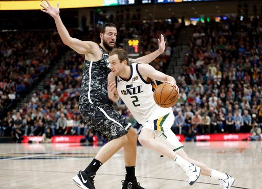 (AP Photo/Rick Bowmer). Utah Jazz forward Joe Ingles (2) drives around San Antonio Spurs center Joffrey Lauvergne in the first half of an NBA basketball game Monday, Feb. 12, 2018, in Salt Lake City.