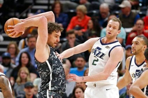 (AP Photo/Rick Bowmer). San Antonio Spurs center Pau Gasol, left, passes the ball as Utah Jazz's Joe Ingles (2) and Rudy Gobert, right, look on in the first half during an NBA basketball game Monday, Feb. 12, 2018, in Salt Lake City.