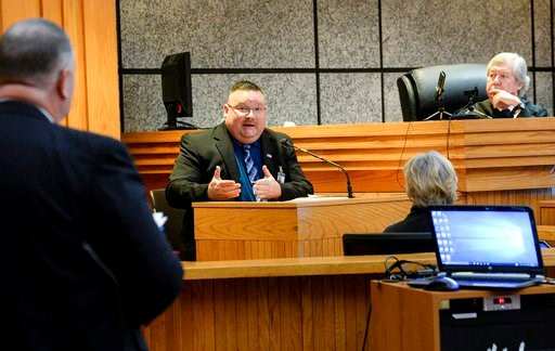 (Ken Ruinard/The Independent-Mail via AP, Pool). David Wagner, left, Tenth Circuit Solicitor, and Judge Edgar Long, right, listens to Tracy Call, middle, Anderson County Sheriff's office investigator, during a waiver hearing for Jesse Osborne.