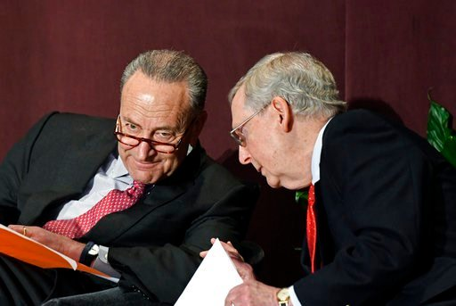 (AP Photo/Timothy D. Easley). Senate Minority Leader Charles Schumer, D-N.Y., left, talks with Senate Majority Leader Mitch McConnell, R-Ky., before his speech at the McConnell Center's Distinguished Speaker Series Monday, Feb. 12, 2018.