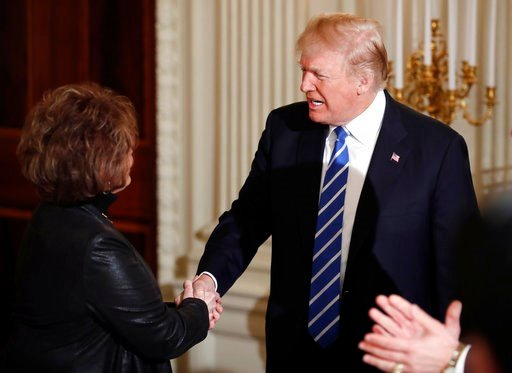 (AP Photo/Carolyn Kaster). President Donald Trump shakes hands with Iowa House Speaker Linda Upmeyer, as he arrives in the State Dining Room of the White House in Washington, Monday, Feb. 12, 2018, during a meeting with state and local officials about ...