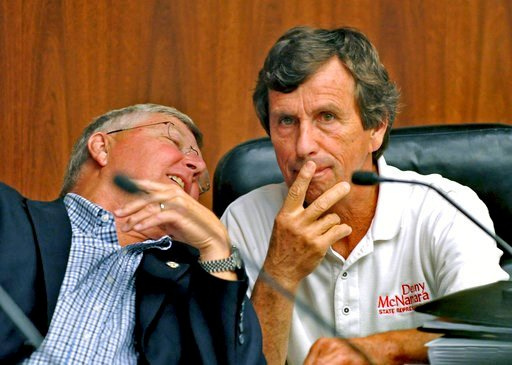 (Dave Orrick/Pioneer Press via AP). In a Sept. 9, 2014 photo, Minnesota State Sen. Tom Saxhaug, DFL-Grand Rapids, left, whispers to State Rep. Denny McNamara, R-Hastings, during a meeting of the Lessard-Sams Outdoor Heritage Council meeting in St. Paul...