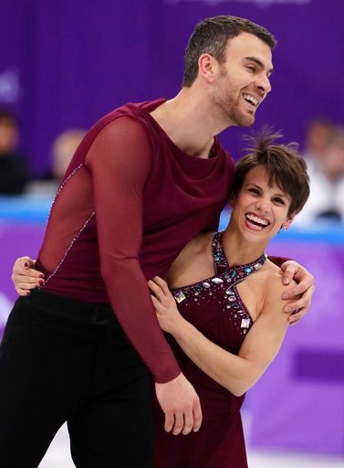(AP Photo/Julie Jacobson). Meagan Duhamel and Eric Radford of Canada react after their performance in the team event pair skating in the Gangneung Ice Arena at the 2018 Winter Olympics in Gangneung, South Korea, Sunday, Feb. 11, 2018.