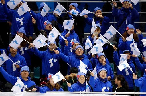 (AP Photo/Julio Cortez). Korean supporters cheer after the preliminary round of the women's hockey game between Sweden and the combined Koreas at the 2018 Winter Olympics in Gangneung, South Korea, Monday, Feb. 12, 2018. Sweden won 8-1.