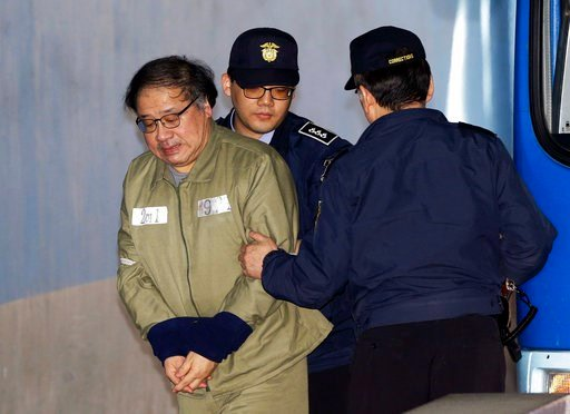 (AP Photo/Ahn Young-joon). Former senior presidential aide Ahn Jong-beom, left, who faces six charges including abuse of power, arrives at the Seoul Central District Court in Seoul, South Korea, Tuesday, Feb. 13, 2018. A South Korean court is set to de...