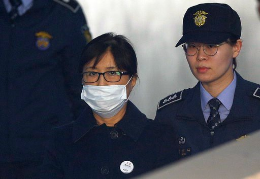 (AP Photo/Ahn Young-joon). Choi Soon-sil, center, a confidante of former South Korean President Park Geun-hye, arrives at the Seoul Central District Court in Seoul, South Korea, Tuesday, Feb. 13, 2018. Choi Soon-sil, a confidante of former South Korean...