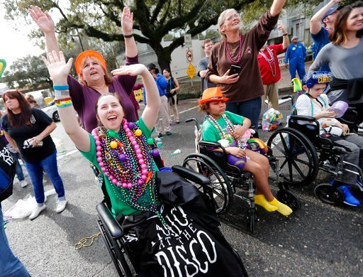 (AP Photo/Gerald Herbert). Patients from Children's Hospital of New Orleans wave for beads and trinkets outside the facility during the Krewe of Thoth Mardi Gras parade in New Orleans, Sunday, Feb. 11, 2018. The krewe's original parade route was design...