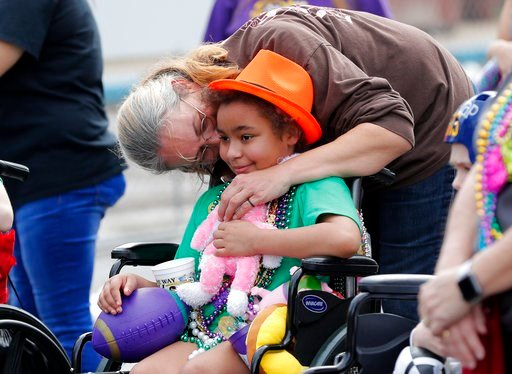 (AP Photo/Gerald Herbert). Brandy Catrett kisses her daughter Ashley Reynolds, a patient at Children's Hospital of New Orleans, outside the facility during the Krewe of Thoth Mardi Gras parade in New Orleans, Sunday, Feb. 11, 2018. The krewe's original...
