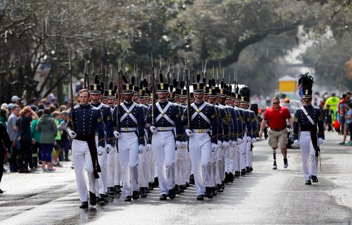 (AP Photo/Gerald Herbert). A military drill team marches during the Krewe of Thoth Mardi Gras parade in New Orleans, Sunday, Feb. 11, 2018. The krewe's original parade route was designed specifically to serve people who were unable to attend other para...