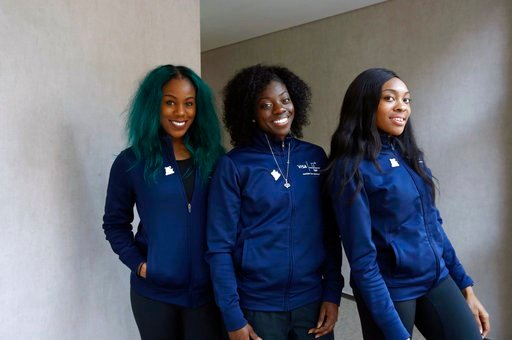(AP Photo/Patrick Semansky). Members of the Nigerian women's bobsled team, from left, Akuoma Omeoga, Seun Adigun and Ngozi Onwumere, pose for a photograph during an interview with The Associated Press at the 2018 Winter Olympics in Pyeongchang, South K...