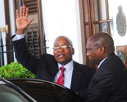 (AP Photo, File). FILE - In this Feb. 6, 2018, file photo, South African President Jacob Zuma waves as he leaves parliament in Cape Town, South Africa, after it was announced that this year's state of the nation address that was to be delivered on Thur...