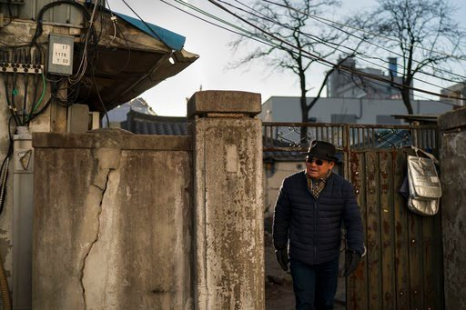 (AP Photo/Felipe Dana). Song Hong, walks in downtown Gangneung, South Korea, Monday, Feb. 12, 2018. Song and his wife, Chong, arrived with their son, daughter-in-law and two grandchildren last week to explore a very different city than the one they lef...