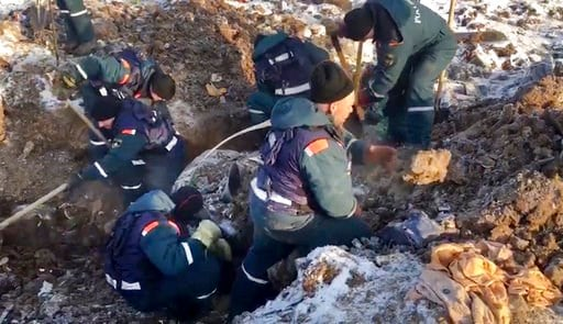 (Russian Ministry for Emergency Situations photo via AP). In this photo provided by the Russian Emergency Situations Ministry, emergency personnel works at the scene of an AN-148 plane crash in Stepanovskoye village, about 40 kilometers (25 miles) from...
