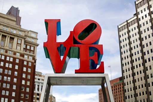 (AP Photo/Matt Rourke, File). FILE - This Nov. 10, 2010, file photo, shows artist Robert Indiana's LOVE sculpture in John F. Kennedy Plaza, also known as Love Park, in Philadelphia. The sculpture, temporarily relocated in 2016 before renovations to the...