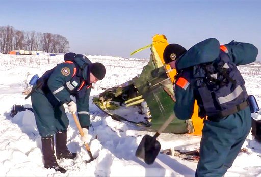 (Russian Ministry for Emergency Situations photo via AP). In this photo provided by the Russian Emergency Situations Ministry, an emergency team works at the scene of a AN-148 plane crash in Stepanovskoye village, about 40 kilometers (25 miles) from th...
