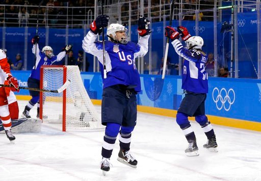 (AP Photo/Matt Slocum). Players from the United States celebrate after Kacey Bellamy scores a goal against the team from Russia during the first period of the preliminary round of the women's hockey game at the 2018 Winter Olympics in Gangneung, South ...