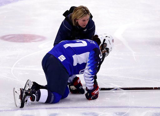 (AP Photo/Frank Franklin II). Amanda Pelkey, of the United States, is checked by team doctor Ally Howe during the first period of the preliminary round of the women's hockey game against the team from Russia at the 2018 Winter Olympics in Gangneung, So...