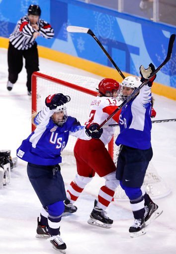 (AP Photo/Frank Franklin II). Gigi Marvin, left, of the United States, reacts after scoring a goal during the second period of the preliminary round of the women's hockey game against the team from Russia at the 2018 Winter Olympics in Gangneung, South...