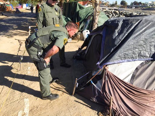 (Bill Alkofer/The Orange County Register via AP, File). FILE - In this Jan 22, 2018, file photo, Orange County Sheriff's deputies tell people they need to begin he process of packing up along the Santa Ana riverbed in Anaheim, Calif. Homeless residents...