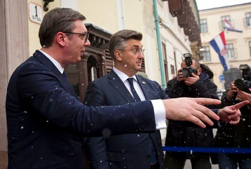 (AP Photo/Darko Bandic). Serbia's president Aleksandar Vucic, left, gestures as he is welcomed by Croatian prime minister Andrej Plenkovic in Zagreb, Croatia, Monday, Feb. 12, 2018. President Vucic is on a two day state visit to Croatia.