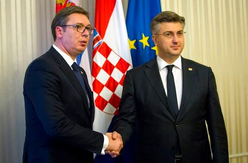 (AP Photo/Darko Bandic). Serbia's president Aleksandar Vucic, left, is welcomed by Croatian prime minister Andrej Plenkovic, in Zagreb, Croatia, Monday, Feb. 12, 2018. President Vucic is on a two day state visit to Croatia.