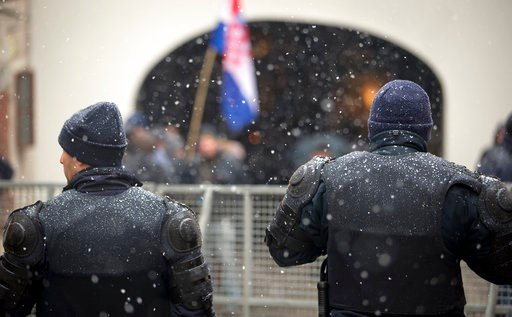 (AP Photo/Darko Bandic). Police cordons off the government building area to prevent protesters access ahead of Serbia's president Aleksandar Vucic visit in Zagreb, Croatia, Monday, Feb. 12, 2018. President Vucic is on two day state visit to Croatia.