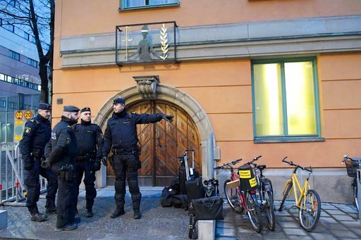 ( Janerik Henriksson/ TT via AP). Police officers stand outside a  court in Stockholm  Tuesday February 13, 2018. The trial has started of an Uzbek man Rakhmat Akilov who has confessed to ramming a stolen truck into a crowd in downtown Stockholm last y...