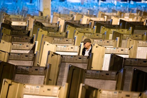 (AP Photo/Matt Rourke, File). FILE- In this Oct. 14, 2016, file photo, a technician works to prepare voting machines to be used in the upcoming presidential election, in Philadelphia. Since last July, a bipartisan team at Harvard, including former U.S....