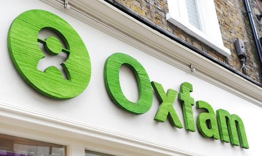 (Nick Ansell/PA via AP, file). FILE: _ This is a May 21, 2015 file  photo of an Oxfam store in London. Oxfam's deputy chief executive on Monday Feb. 12, 2018 resigned amid the scandal involving sex abuse in Haiti after the 2010 earthquake. Penny Lawren...