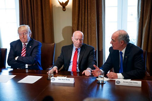 (AP Photo/Evan Vucci). Rep. Kevin Brady, R-Texas, center, and President Donald Trump listen to Sen. Bob Casey, D-Pa., speak during a meeting with lawmakers about trade policy in the Cabinet Room of the White House, Tuesday, Feb. 13, 2018, in Washington.
