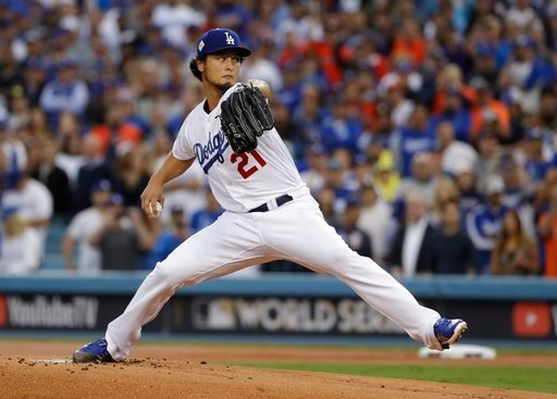 (AP Photo/Matt Slocum, File). FILE - In this Nov. 1, 2017, file photo, Los Angeles Dodgers starting pitcher Yu Darvish throws during the first inning of Game 7 of baseball's World Series against the Houston Astros, in Los Angeles. Perhaps 100 free agen...