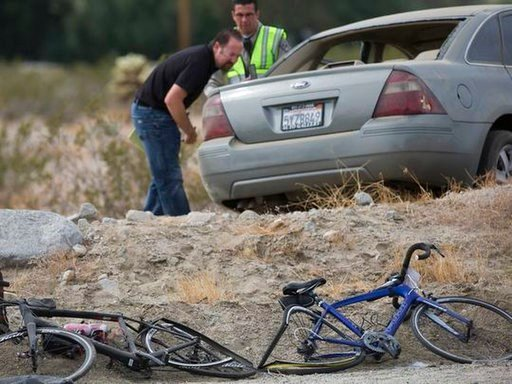 (Omar Ornelas/The Desert Sun via AP ). California Highway Patrol investigators inspect a vehicle that struck two cyclists participating in the 2018 Tour de Palm Springs near Indio Hills, Calif., Saturday, Feb. 10, 2018. Police say the car seen was driv...