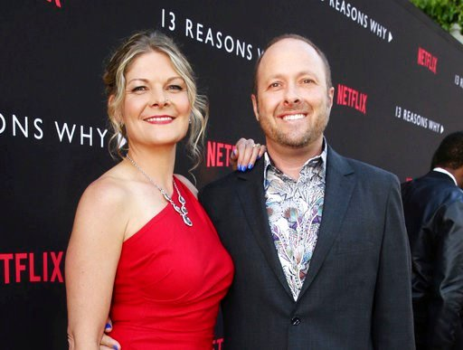"(Photo by Steve Cohn/Netflix via AP). In this March 30, 2017 photo, Joan Marie and Author Jay Asher appear at the Netflix ""13 Reasons Why"" premiere in Los Angeles. A planned second season of ""Thirteen Reasons Why"" on Netflix will be unaffected by the r..."