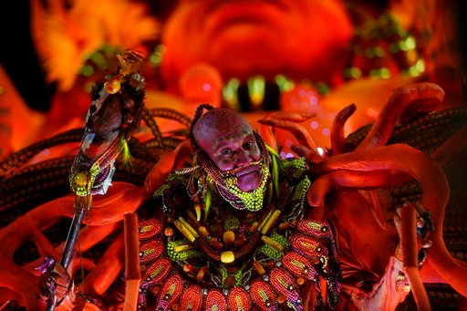 (AP Photo/Silvia Izquierdo). A performer from the Salgueiro samba school parades during Carnival celebrations at the Sambadrome in Rio de Janeiro, Brazil, early Tuesday, Feb. 13, 2018.