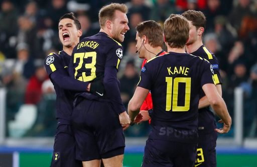(AP Photo/Antonio Calanni). Tottenham's Christian Eriksen, 2nd left, celebrates with teammate Erik Lamela and Harry Kane, right, after scoring his side's second goal during the Champions League, round of 16, first-leg soccer match between Juventus and ...