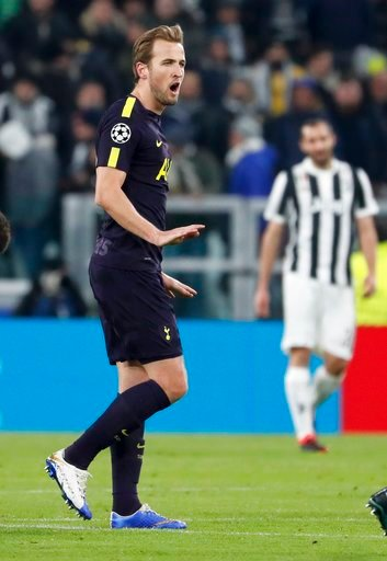 (AP Photo/Antonio Calanni). Tottenham's Harry Kane celebrates after scoring his side's opening goal during the Champions League, round of 16, first-leg soccer match between Juventus and Tottenham Hotspurs, at the Allianz Stadium in Turin, Italy, Tuesda...