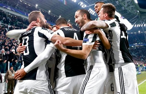 (AP Photo/Antonio Calanni). Juventus' Gonzalo Higuain, left, celebrates with teammates after scoring during the Champions League, round of 16, first-leg soccer match between Juventus and Tottenham Hotspurs, at the Allianz Stadium in Turin, Italy, Tuesd...