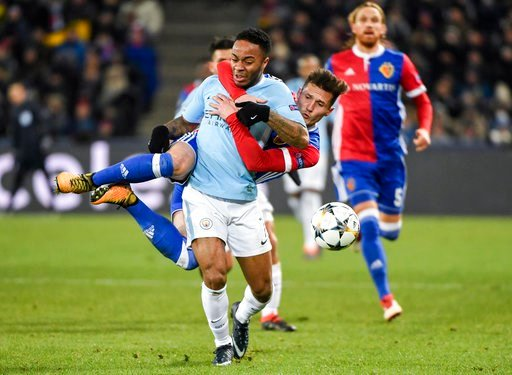 (Georgios Kefalas/Keystone via AP). Basel's Taulant Xhaka, behind, clings to Manchester City's Raheem Sterling, front, and gets a yellow card for this action, during the UEFA Champions League round of sixteen first leg soccer match between Switzerland'...