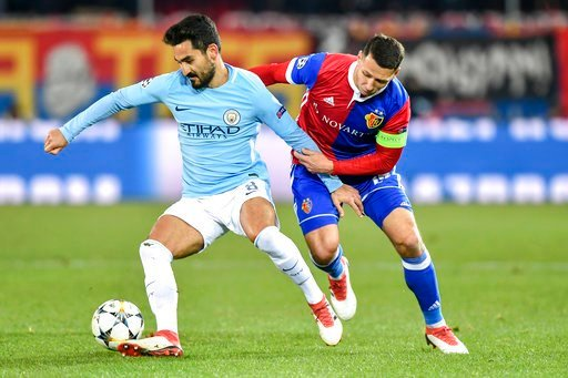 (Walter Bieri/Keystone via AP). Manchester City's Ilkay Gundogan, left, fights for the ball against Basel's Marek Suchy, during the Champions League round of sixteen first leg soccer match between Switzerland's FC Basel 1893 and England's Manchester Ci...