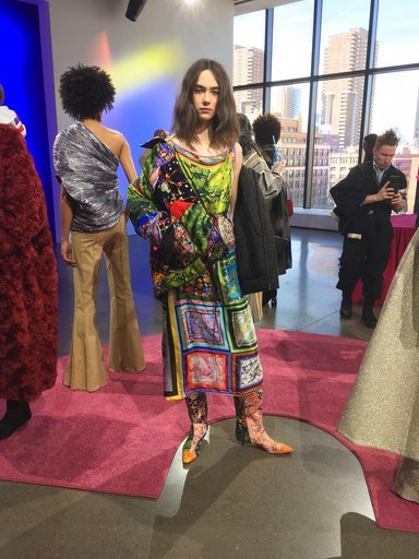 (AP Photo/Jocelyn Noveck). Fashion from the Rosie Assoulin collection is modeled during Fashion Week, Tuesday, Feb. 13, 2018 in New York.