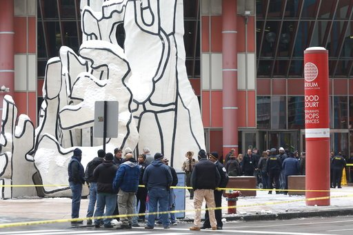 (John J. Kim/Chicago Tribune via AP). Police guard the crime scene after an off-duty Chicago police officer was shot at the James R. Thompson Center,  in Chicago, Tuesday, Feb. 13, 2018. Spokesman Anthony Guglielmi says the off-duty officer was shot ar...
