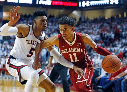 (AP Photo/Brad Tollefson). Oklahoma's Trae Young (11) dribbles the ball around Texas Tech's Justin Gray (5) during an NCAA college basketball game Tuesday, Feb. 13, 2018, in Lubbock, Texas.
