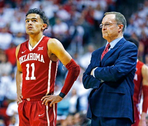 (AP Photo/Brad Tollefson). Oklahoma's Trae Young (11) and coach Lon Kruger watch free throw shots during an NCAA college basketball game against Texas Tech, Tuesday, Feb. 13, 2018, in Lubbock, Texas.